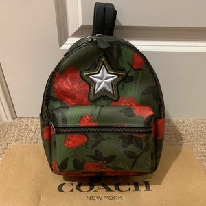 Coach mini backpack with flowers and star
